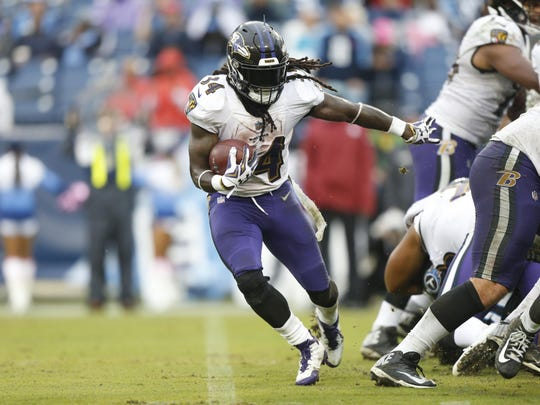 Running back Alex Collins scored two touchdowns in