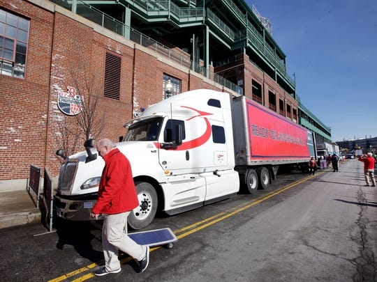 The equipment truck for the Boston Red Sox baseball team stands outside Fenway Park, Monday, Feb. 4, 2019, in Boston. The truck will be heading to JetBlue Park in Fort Myers, Fla. for the players' spring training. (AP Photo/Steven Senne)