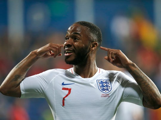 England's Raheem Sterling celebrates after scoring