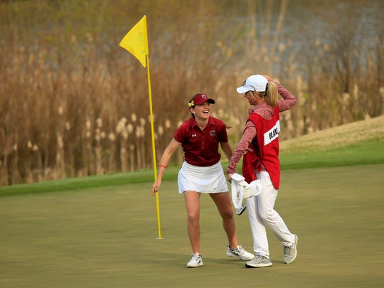 Ainhoa Olarra celebrated with her caddie after making a birdie to advance at the Augusta National Women's Amateur.