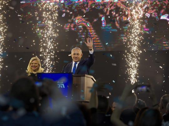 Israel's Prime Minister Benjamin Netanyahu accompanied