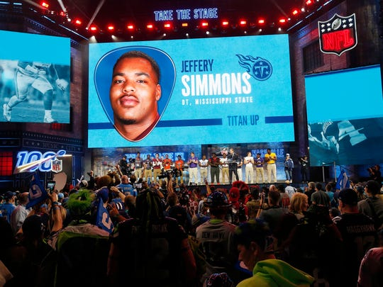 Tennessee high school football players join NFL Commissioner Roger Goodell as Goodell announces that the Tennessee Titans selected Mississippi State's Jeffery Simmons during the first round at the NFL football draft, Thursday, April 25, 2019, in Nashville, Tenn. (AP Photo/Steve Helber)