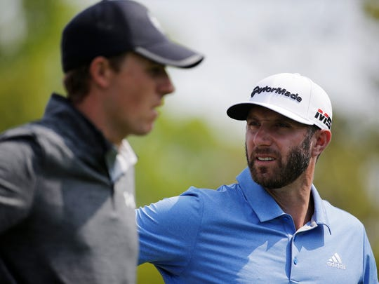 Dustin Johnson, right, and Jordan Spieth prepare to hit off the third tee during the second round of the PGA Championship golf tournament, Friday, May 17, 2019, at Bethpage Black in Farmingdale, N.Y. (AP Photo/Seth Wenig)