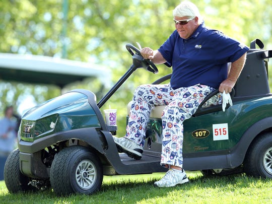 John Daly gets out of his cart on the third green during the first round of the PGA Championship at Bethpage State Park.