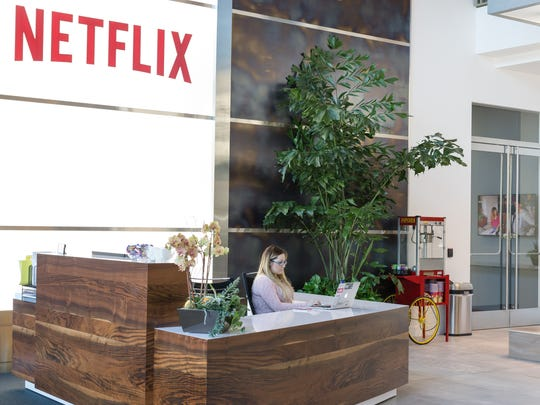 A woman sitting at the front desk at Netflix's office.