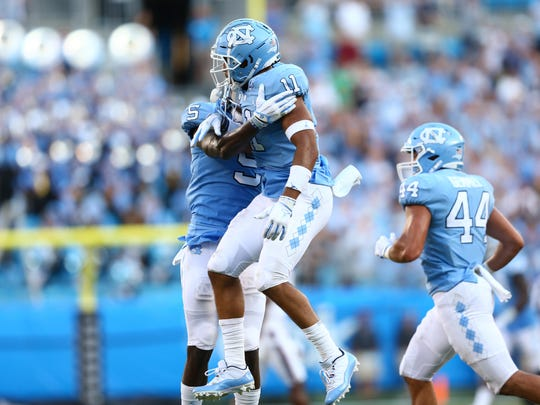 Aug 31, 2019; Charlotte, NC, USA; North Carolina Tar Heels defensive back Myles Wolfolk (11) celebrates an interception with defensive back Patrice Rene (5) during the fourth quarter at Bank of America Stadium. Mandatory Credit: Jeremy Brevard-USA TODAY Sports