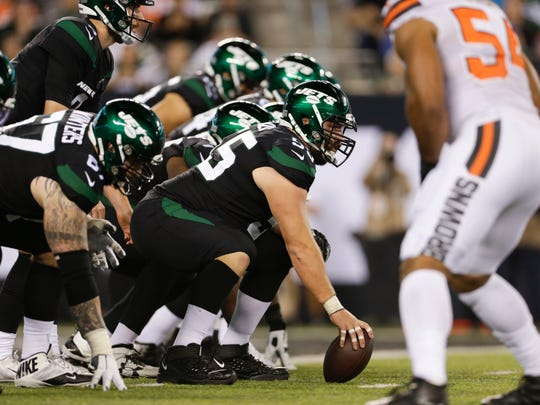 New York Jets center Ryan Kalil (55) lines up with teammates during the second half of an NFL football game against the Cleveland Browns Monday, Sept. 16, 2019, in East Rutherford, N.J. (AP Photo/Adam Hunger)