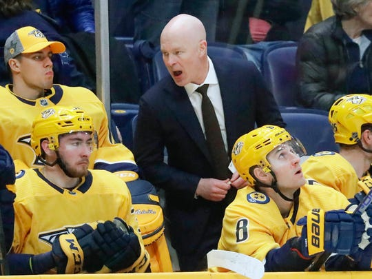 Nashville Predators head coach John Hynes talks to his players in the second period of an NHL hockey game against the Boston Bruins Tuesday, Jan. 7, 2020, in Nashville, Tenn. This is the first game for Hynes since being named the team's new coach. (AP Photo/Mark Humphrey)