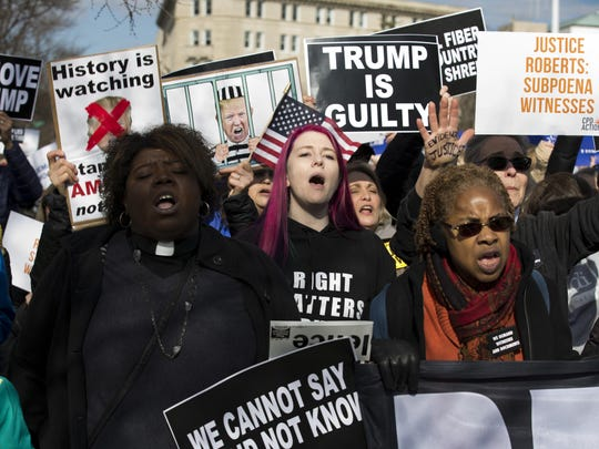 Demonstrators protest outside of the U.S. Capitol, during the Senate impeachment trial of President Donald Trump in Washington, Wednesday, Jan. 29, 2020. (AP Photo/Jose Luis Magana)