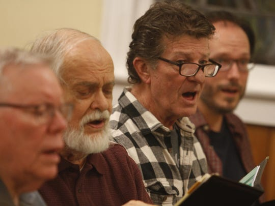 Members of the South Cheatham Choral Society practice new music ahead of the group's spring performance.