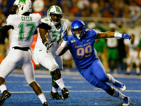 Sep 6, 2019; Boise, ID, USA; Boise State Broncos linebacker Curtis Weaver (99) pressures Marshall Thundering Herd quarterback Isaiah Green (17) during the second half at Albertsons Stadium. Mandatory Credit: Brian Losness-USA TODAY Sports