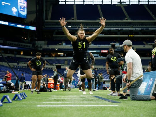 Feb 28, 2020; Indianapolis, Indiana, USA; Alabama Crimson Tide offensive lineman Jedrick Wills (OL51) does the broad jump during the 2020 NFL Combine at Lucas Oil Stadium. Mandatory Credit: Brian Spurlock-USA TODAY Sports