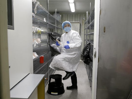 Ivana Vu, an airborne sensor operator, prepares newly sterilized N95 masks in Waukegan, Ill. The mask sterilization site is operated by Battelle, which received a FEMA contract. Officials say the site can sterilize as many as 80,000 masks a day.