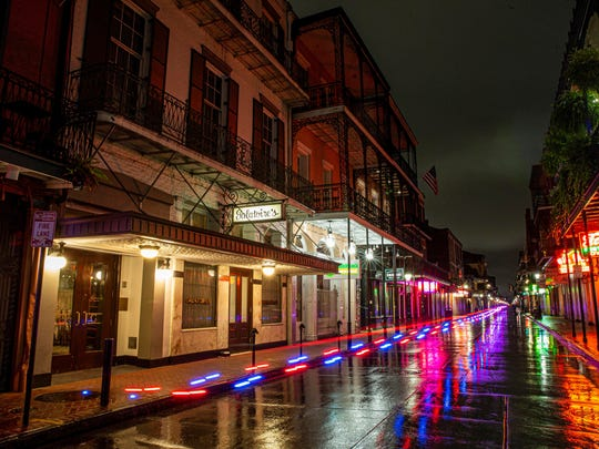 After nearly two months of the stay-at-home coronavirus pandemic mandate, Bourbon Street in New Orleans' French Quarter is completely empty Friday.