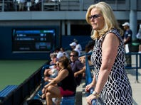 FILE - In this Aug. 24, 2017, file photo, Stacey Allaster, the U.S. Tennis Association's chief executive of professional tennis, watches a qualifying round of the U.S Open, as she was posing for a photo in New York. Allaster is taking over as the U.S. Open's tournament director, the first woman to hold that job at the American Grand Slam tennis tournament. She will stay on as the USTA's chief executive of professional tennis, the association said Wednesday, June 10, 2020. (AP Photo/Michael Noble Jr., File)