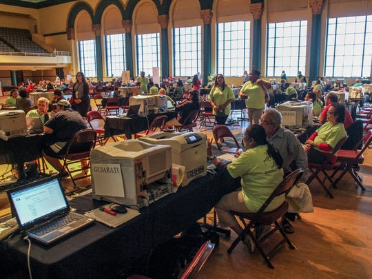 Laid-off Atlantic City casino workers get assistance information in September from various organizations at Boardwalk Hall. New Jersey's job market lags behind the nation's; in 2014, it grew by just 0.7 percent, compared with 2.1 percent for the U.S. as a whole.