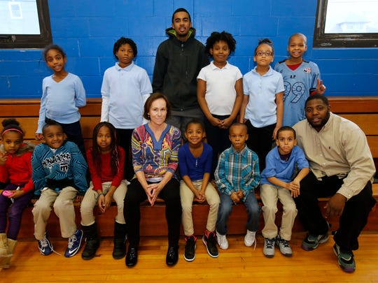 Barbara Carmody with Boys and Girls Club members and volunteers. Carmody and her husband, basketball coach Bill Carmody, founded the tutoring program.