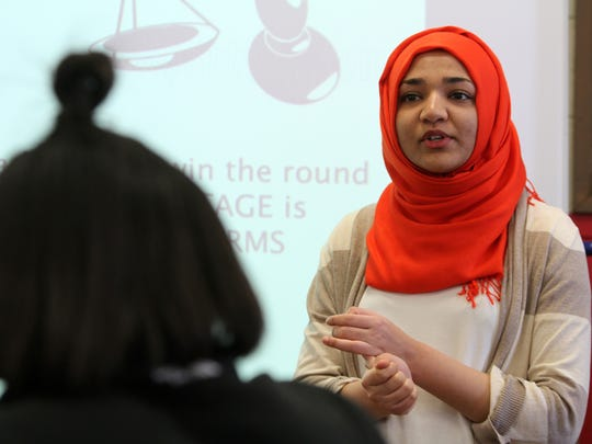 Monmouth University student Sana Rashid, 21, of Ocean Twp. gives a presentation on negative arguments to the Asbury Park High School Debate Team after school in Asbury Park