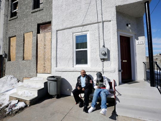 Luis Ruiz, left, sits with his stepson Antonio Arroyo, in front of their refurbished home in Camden. As money has flowed to development in Camden, some trickled back into politics and no donations are as notable as those from Pennsylvania developer Israel Roizman. Last February, the state awarded incentives worth $13.4 million to Broadway Associates 2010 LLC, a real estate development company he controls. The project in question: refurbishing 175 low-income housing units, including the one Ruiz lives in, that deteriorated under two decades of Roizman's ownership.