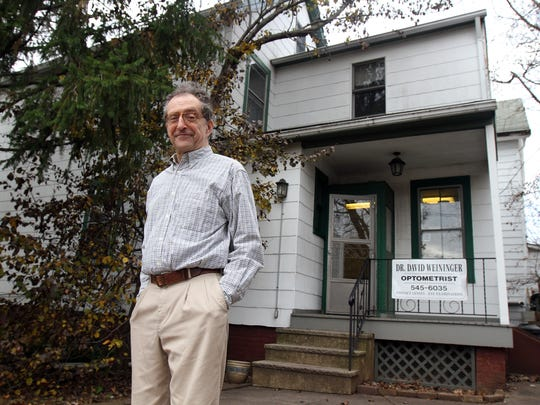 Dr. David Weininger, an optometrist, stands outside of his office in New Brunswick.