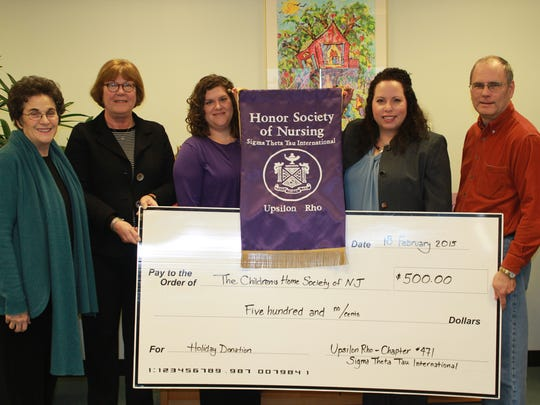 The Upsilon Rho chapter of the Honor Society of Nursing, Sigma Theta Tau International, at Thomas Edison State College in Trenton recently made a $500 charitable donation to The Children's Home Society of New Jersey. Pictured are (from left to right): Donna C. Pressma, president and chief executive officer, The Children's Home Society of New Jersey; Christine Saltzman, secretary, Upsilon Rho Chapter; Holly Leahan, nursing program and graduate practicum advisor, W. Cary Edwards School of Nursing, Thomas Edison State College; Maritza Raimundi-Petroski, director, Maternal/Child Health, Family and Community Support Services, The Children's Home Society of New Jersey; and Gary Fassler, treasurer, Upsilon Rho Chapter. The donation will help provide additional programming and services for two of the society's support services programs, CUNA and Body and Soul. These programs help to provide prenatal health education and a holistic approach to address the cultural and linguistic needs of Latina women.