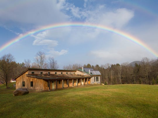 """The Eco-Lodge, completed in 2011, is the pinnacle of the camp's green construction, featuring a a green roof, solar hot water, wood harvested from Common Ground Center land, locally-crafted furniture and non-toxic clay plaster """"paint."""""""