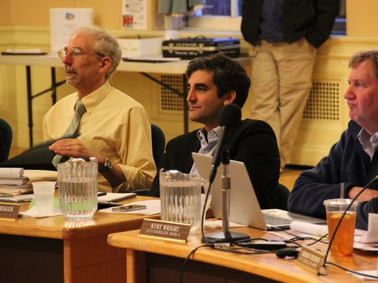 From left, Chief Administrative Officer Bob Rusten, Mayor Miro Weinberger and Councilor Kurt Wright, R-Ward 4, listen to members of the public speak about the Burlington school budget during Monday's City Council Meeting at City Hall.