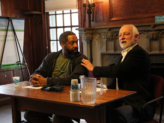 Chairman of the Goddard College Faculty Council Herukhuti, left, and Interim President Robert Kenny hold a news conference at the college on Sunday after commencement.