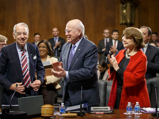 Sen. Patrick Leahy, D-Vt., center, the outgoing chairman of the Senate Judiciary Committee, applauds new committee chairman Sen. Chuck Grassley, R-Iowa, left, joined by Sen. Dianne Feinstein, D-Calif., right, on Capitol Hill in Washington, Thursday, Jan. 22, 2015, as the veteran senators hold an organizational meeting under the new Republican majority.
