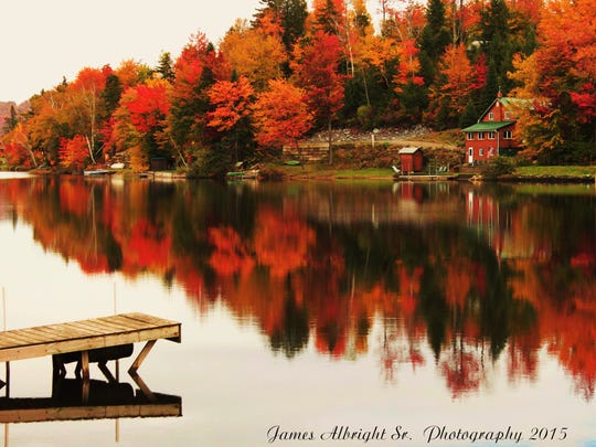 Dock reflections and fall colors from Eden Mills.