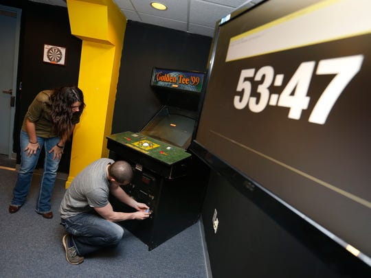 Aaron Coy is adding ax-throwing to his downtown Des Moines entertainment venue that also includes Escape Chambers, a game that requires participants to solve clues to escape a locked room.