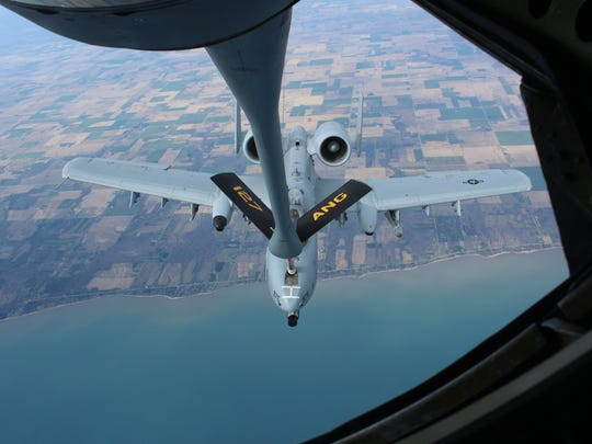 An A-10 fighter jet from the 127th Air National Guard unit based at Selfridge Base in Harrison Township makes contact with a KC-135 Stratotanker during a refueling exercise Tuesday, March 27, 2012 above Michigan's thumb-area. The mission at 16,000 feet lasted only a few minutes for each plane. MIKE BROOKBANK/Detroit Free Press