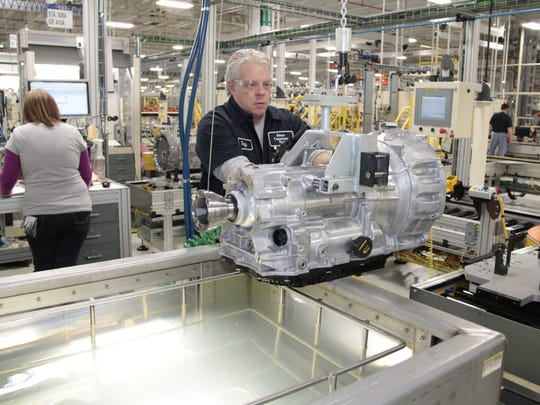 A worker, not the person diagnosed with COVID-19, inspects a transmission at Fiat Chrysler's Kokomo Transmission Plant. An employee there, believed to be salaried, has tested positive for the coronavirus.