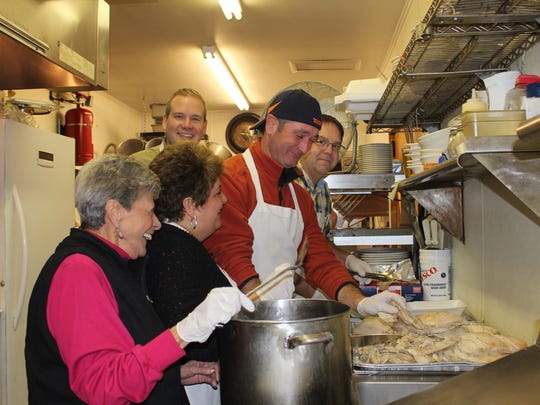 ACT-N-DO volunteers prepare turkeys for their Thanksgiving