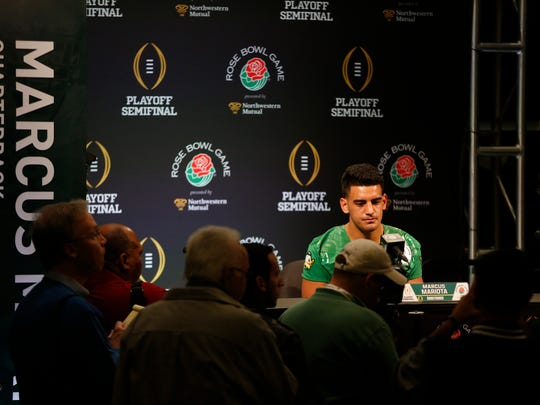Joe Rondone/Democrat Marcus Mariota meets with journalists at the LA Hotel Downtown Rose Bowl Press Conference on Monday.