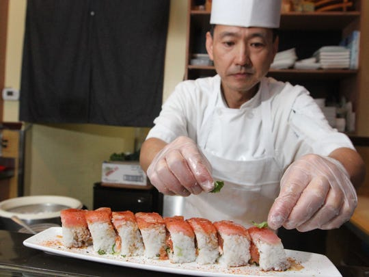 Chef Atsunori Ichimura prepares a Louisiana Roll at Origami.