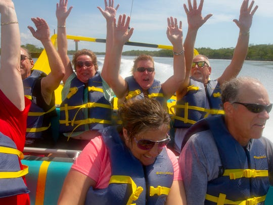 A group of passengers and members of The News-Press participate in one of the Jet Boat Fun rides on Monday afternoon (03/16/15).
