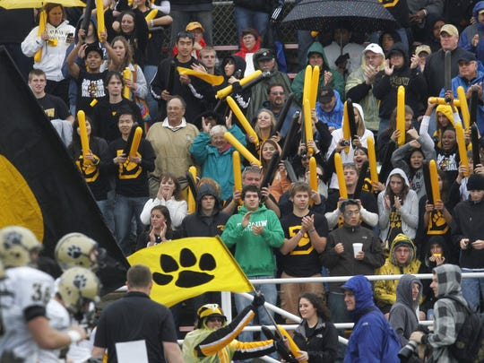 DePauw University fans cheer on the Tigers as they take the field for the 117th meeting with Wabash College at Hollett Little Giant Stadium in Crawfordsville. Wabash won the Monon Bell Classic on Saturday, November 13, 2010, beating DePauw by a score of 47-0. Charlie Nye / The Star.
