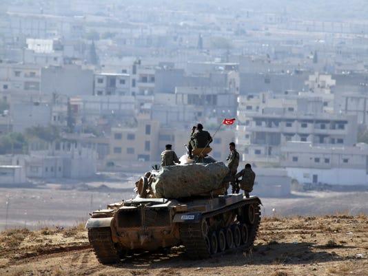 2014 416583655-Turkey_Syria_AXLP122_WEB348501.jpg_20141009.jpg