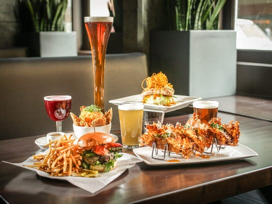 Surf and turf grilled burger, Vampire tacos, Moo Shu Egg Rolls, and Ginger Crusted Norwegian Salmon, from Yard House Brewery, 15 Maryland St, Indianapolis, Wednesday March 18th, 2015. The brewery opens it's downtown location, March 25th, 2015.
