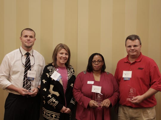 Representatives from Goodwill's Employer Partners of the Year, Advantage Staffing, Cox Oil and Max Trans, gather for a photo Friday at Goodwill's Impact Luncheon in Jackson. From left: Dustin McBride of Cox Oil; Heather Tinker and Tammy Lamb of Advantage Staffing; and Stewart McGowan of Max Trans.