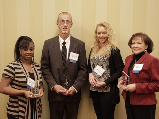From left, Goodwill's 110 Percent Award winner Tiffany Thompson poses for a photo Friday with three Graduates of the Year, Jeffery Jackson, Tonia Brown and Lisa Turner, at Goodwill's Impact Luncheon in Jackson.