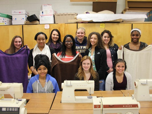 WMHS Sewing 2 students with bibs.jpg