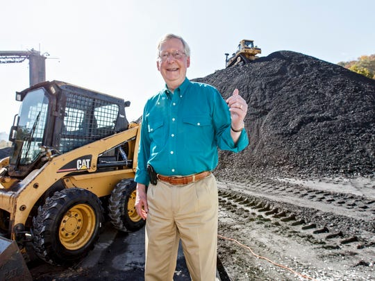 In this Oct. 27, 2014 file photo, Senate Minority Leader Mitch McConnell of Ky., a 30-year incumbent, greets people at a coal tipple operation, B&W Resources in Manchester, Ky. McConnell easily won re-election Tuesday by tying Democratic challenger Alison Lundergan Grimes to unpopular President Barack Obama. Coal mining was a major part of how McConnell did that, accusing Grimes of supporting Obama's energy policies that have made it difficult to replace the state's aging fleet of coal-fired power plants that supply 90 percent of the state's electricity.