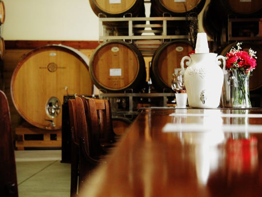 The tasting room is housed in an open-kitchen style in a 7,000-square-foot barn.