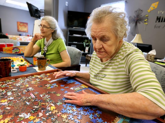 Adults with early onset Alzheimer's Disease attend Elder's First, a daytime program that offers activities and opportunities to help keep their minds stimulated.