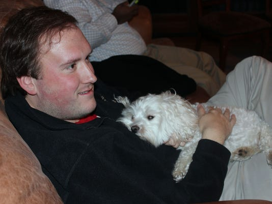 Scott Kriebel and the family canine, Marley, watch the Super Bowl action..jpg