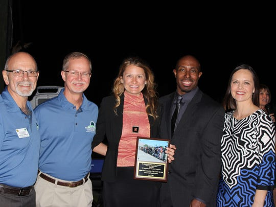 Office of Sustainability commissioners Victor Yepello and Joe Jackson, and manager Michele Mician, receive a Community Partner Award from Cielo Vista Charter Assistant Principal Devlinn Clinton and Benefit Co-Chair Cara Van Dijk.