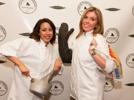Tiffany Billman and Kate Patay attend the grand opening of Reno Provisions, chef Mark Estee's new culinary complex on North Sierra Street in downtown Reno.