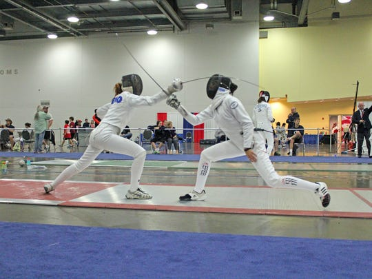 Megan Eno (left) spars on her way to a Division II Women's Epee competition gold medal in Columbus, Ohio, in June.